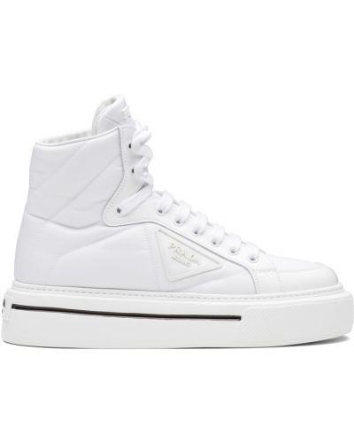Белые кожаные кеды Prada