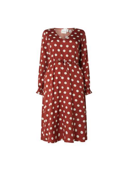 Sukienka rozkloszowana w grochy z długimi rękawami Junarose