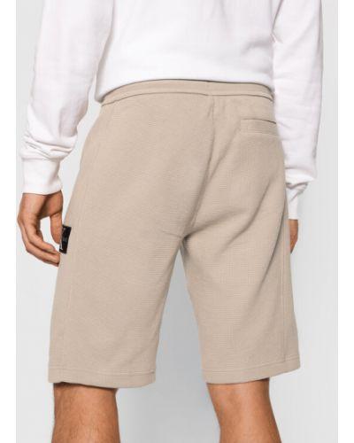 Beżowe spodenki sportowe Calvin Klein Jeans