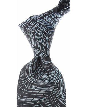 Czarny krawat w paski z jedwabiu Calvin Klein