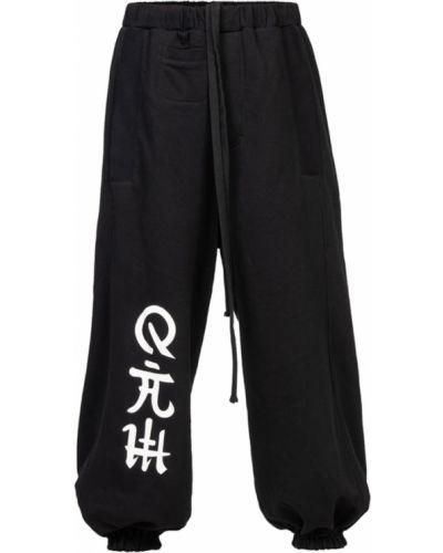 Czarne spodnie oversize Robert Kupisz