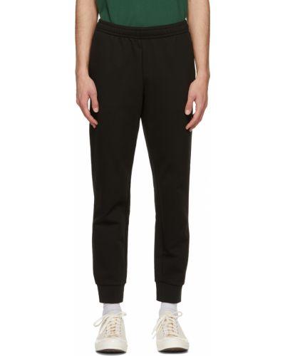 Флисовые спортивные брюки - черные Lacoste