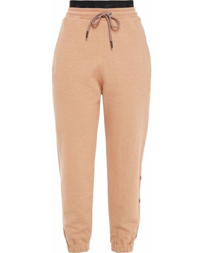 Хлопковые желтые укороченные брюки с карманами Reebok X Victoria Beckham