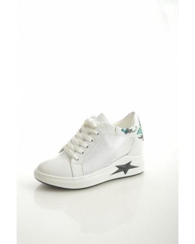 Кожаные белые кроссовки Chezoliny