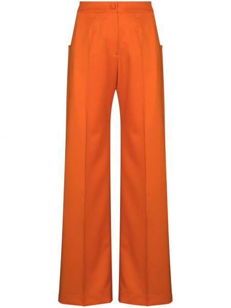 Оранжевые со стрелками расклешенные брюки с высокой посадкой Matériel