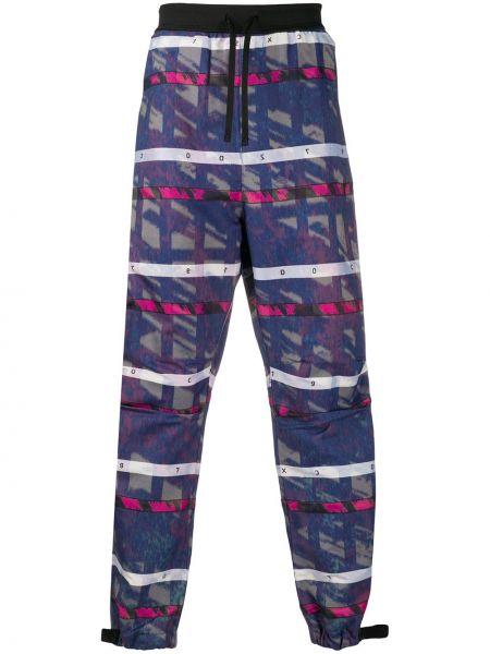Niebieskie spodnie w paski bawełniane Stone Island Shadow Project