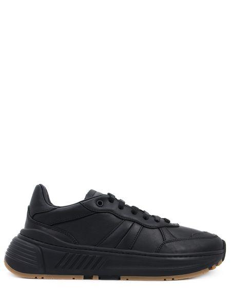 Кожаные черные кроссовки на толстой подошве на шнуровке Bottega Veneta