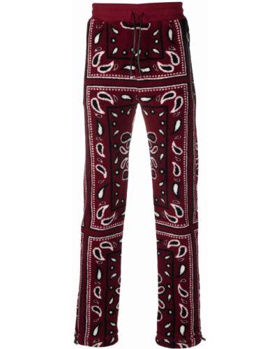 Красные брюки с накладными карманами Amiri