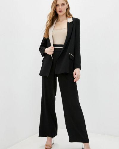 Костюмный черный брючный костюм Joymiss