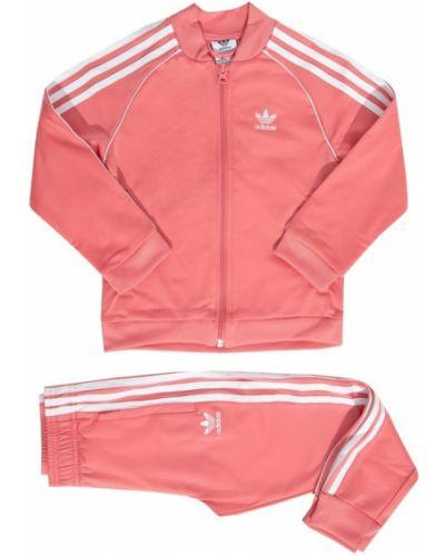 Różowy dres oversize w paski Adidas