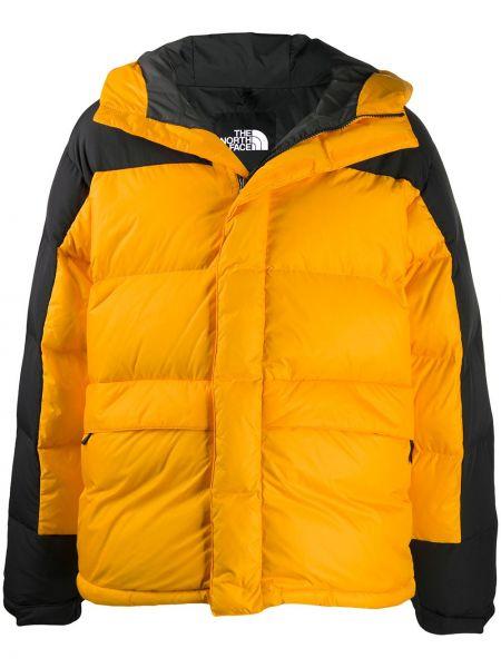 Желтая пуховая длинная куртка с капюшоном The North Face