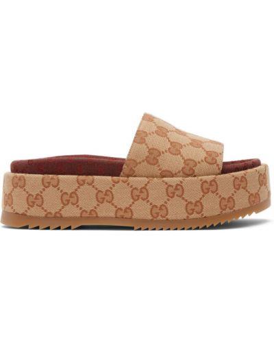 Beżowe złote sandały na platformie Gucci