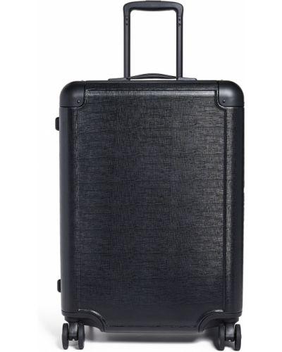 Czarna walizka średnia Calpak