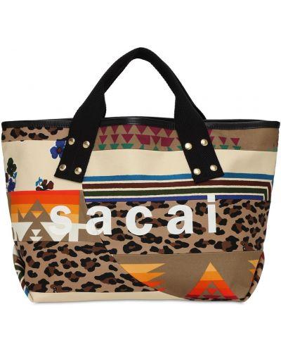 Beżowa torebka z printem Sacai