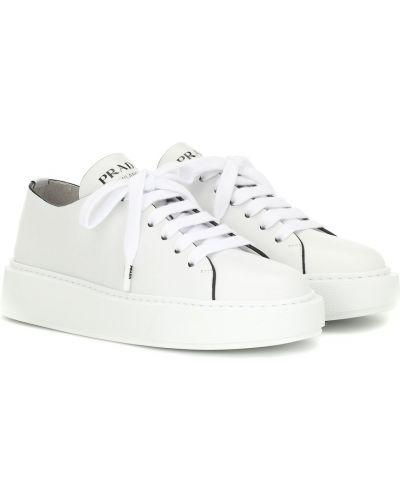 Кожаные кроссовки белый Prada