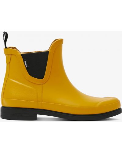 Резиновые сапоги на каблуке - желтые Tretorn