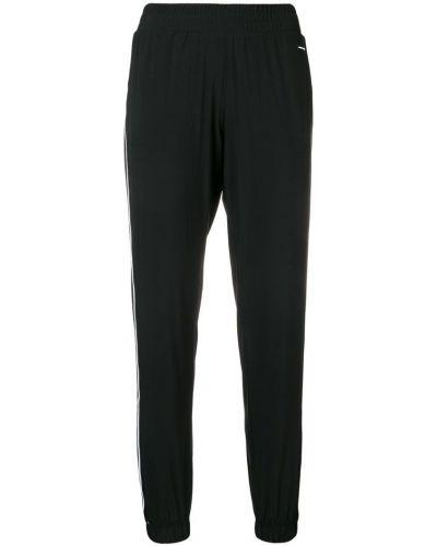 Спортивные брюки с карманами свободные Dkny