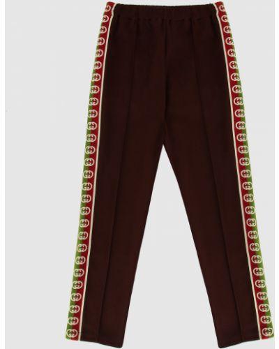 Повседневные коричневые брюки Gucci