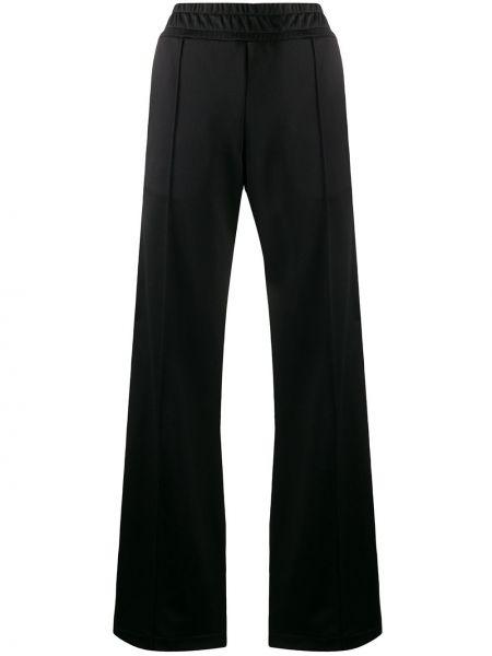 Спортивные брюки расклешенные с поясом Fendi