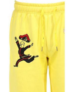 Żółte joggery z haftem bawełniane Kidsuper Studios
