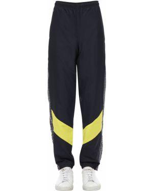 Спортивные брюки в клетку с лампасами Lacoste