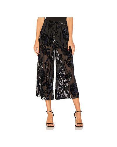 Черные брюки прозрачные Chrissy Teigen