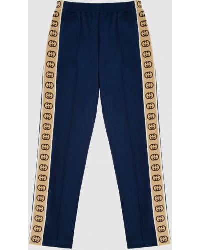 Синие спортивные брюки Gucci