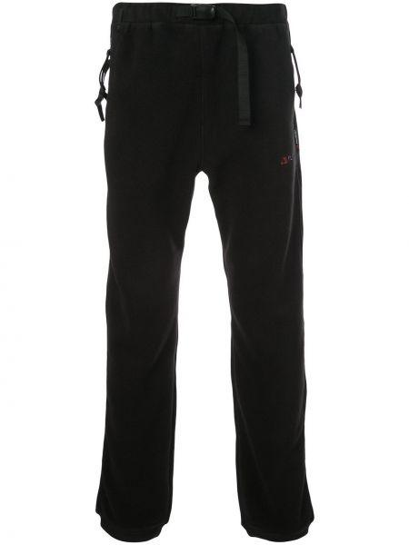 Czarne spodnie z paskiem Manastash