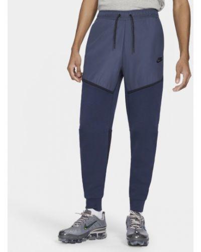Niebieski joggery z kieszeniami z mankietami Nike