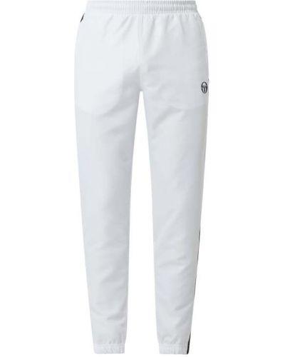 Białe spodnie Sergio Tacchini