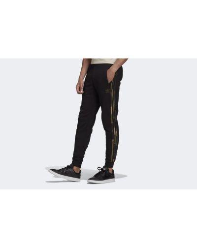 Czarne spodnie w paski bawełniane Adidas
