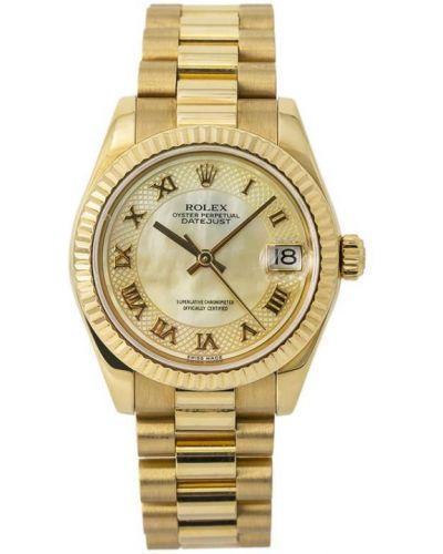 Золотистые часы золотые круглые Rolex