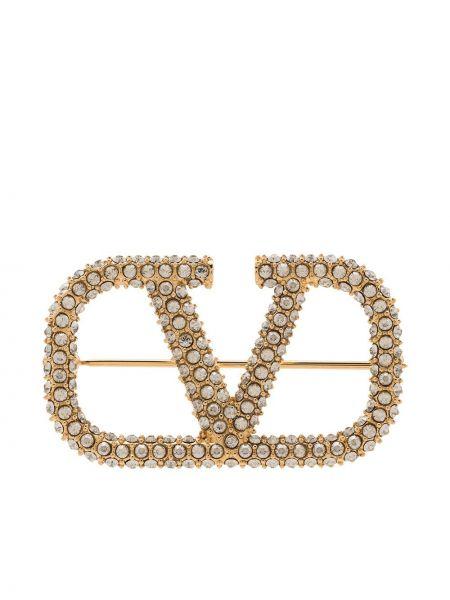 Złota broszka Valentino Garavani