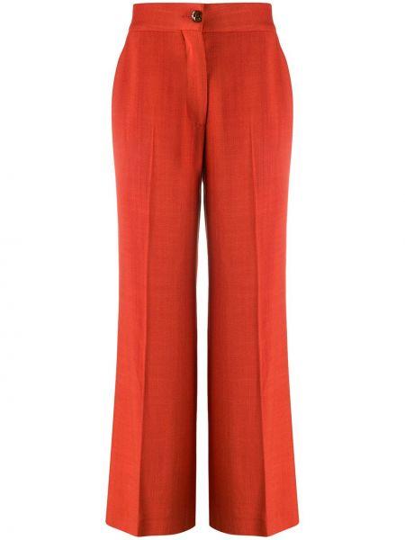 Оранжевые свободные брюки с карманами на пуговицах свободного кроя Blazé Milano