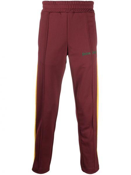 Czerwony spodnie w paski z boku z paskami z kieszeniami Palm Angels