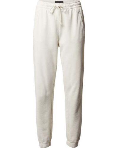 Białe spodnie dresowe bawełniane Drykorn
