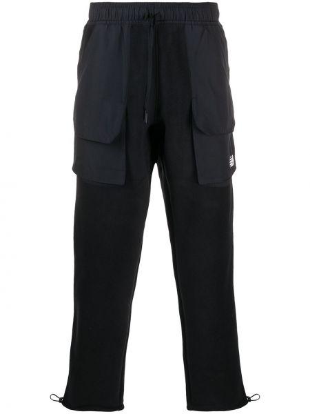 Прямые черные брюки с карманами New Balance