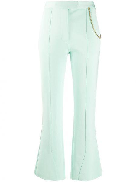 Spodni rozbłysnął zielony przycięte spodnie z kieszeniami Givenchy