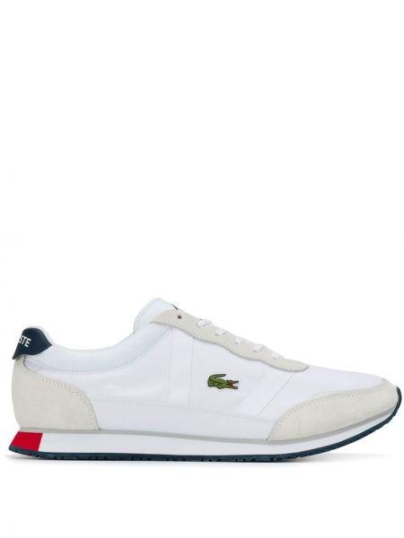 Кроссовки на каблуке Lacoste