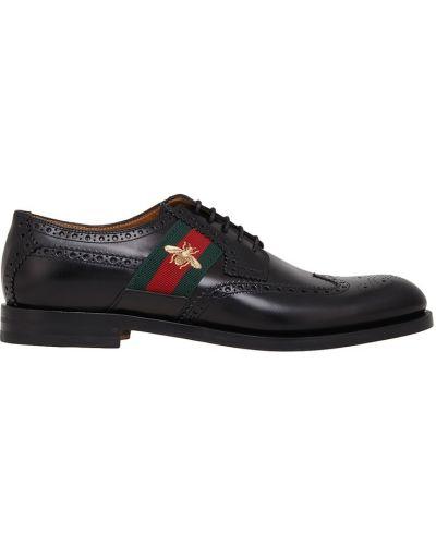 Классические туфли кожаные с вышивкой Gucci