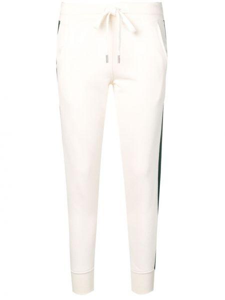Белые спортивные брюки с нашивками с манжетами с карманами Roqa