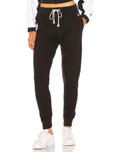 Czarny klasyczne spodnie z mankietami z haftem z kieszeniami Champion