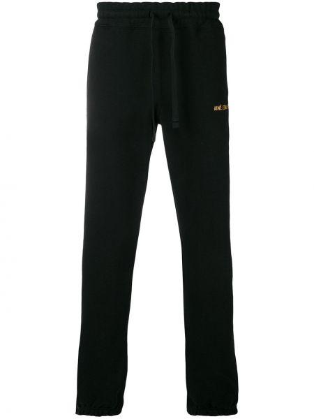 Czarne spodnie bawełniane z haftem Aime Leon Dore