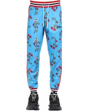 Niebieskie spodnie w paski z haftem Minimal