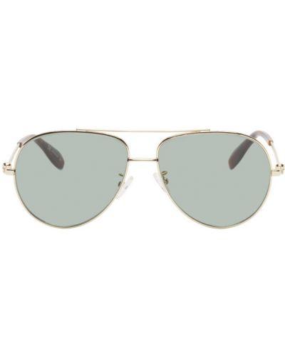 Кожаные солнцезащитные очки золотые с черепами Alexander Mcqueen