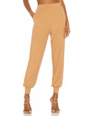 Prążkowane spodnie peep toe Camila Coelho