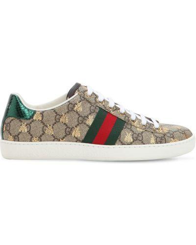 Beżowe sneakersy skorzane na obcasie Gucci