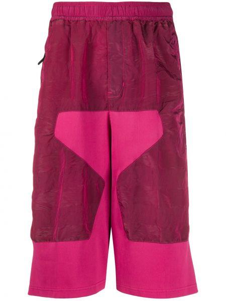 Różowe spodnie z aksamitu z printem Stone Island Shadow Project