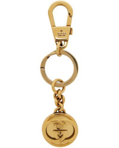 Брелок металлический золотой Gucci