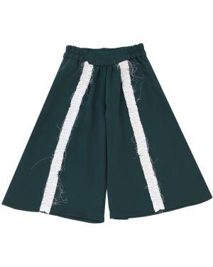 Zielone spodnie z falbanami Mummymoon